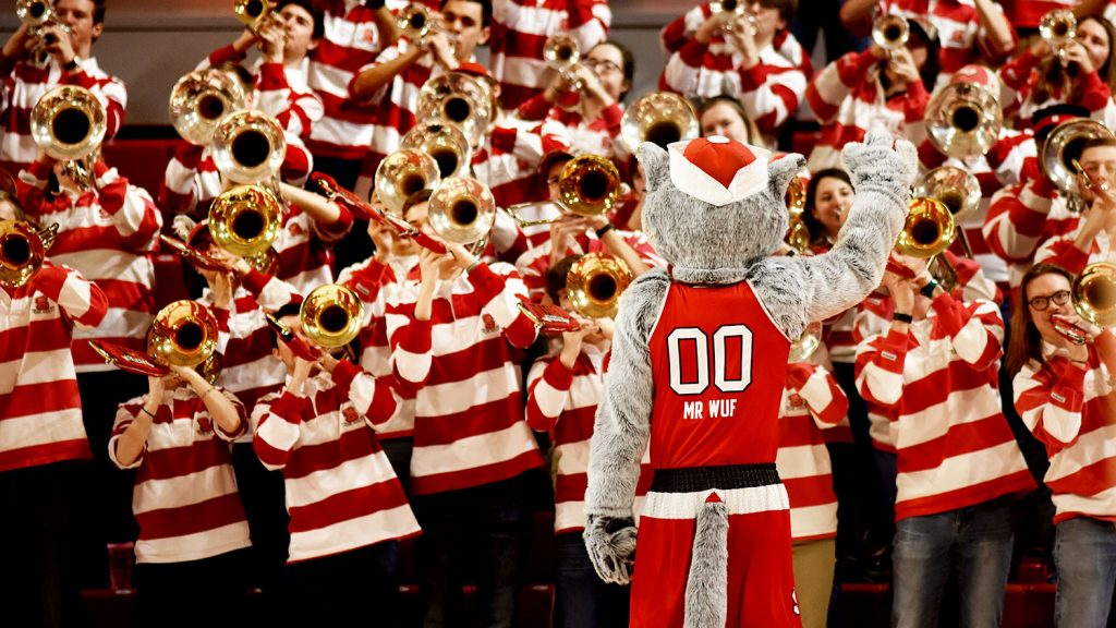 Mr Wuf conducts the pep band during a time-out at the women's basketball game in Reynolds Coliseum.