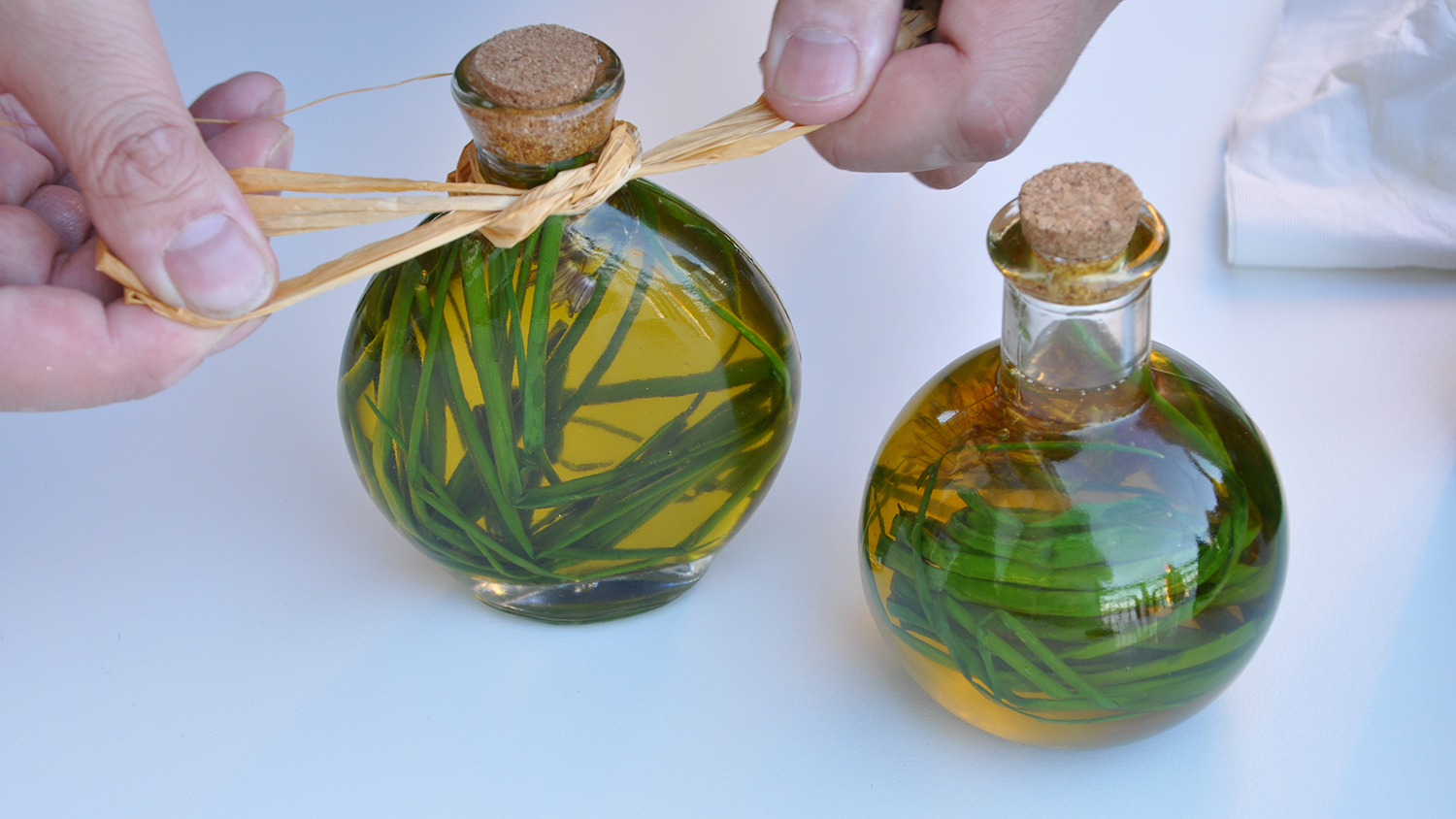 two bottles of infused oil