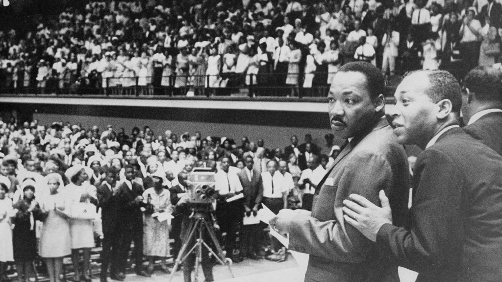 Martin Luther King Jr. prepares to go on stage at Reynolds Coliseum on July 31, 1966, in front of an integrated crowd of 5,000 and a UNC-TV audience. [Photo courtesy of the State Archives of North Carolina.]