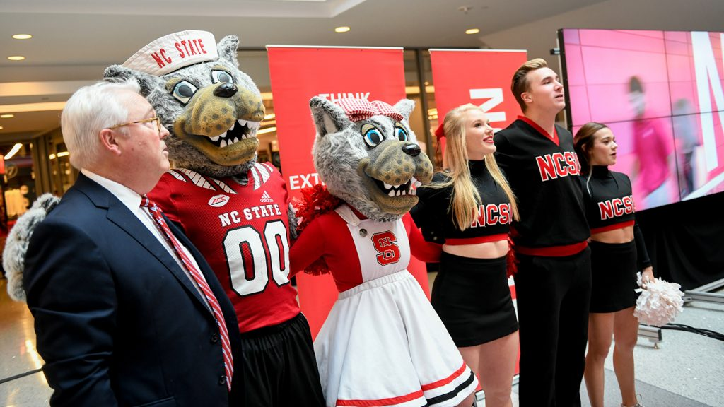 The chancellor sings the alma mater with mascots and students during fall address.