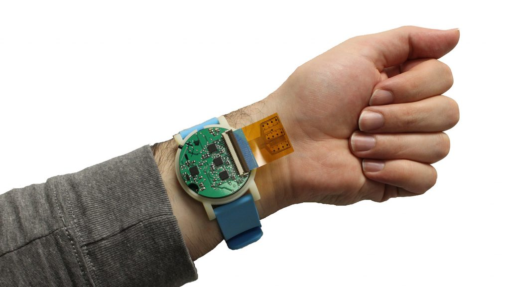 wristwatch-like sensor being worn on someone's arm