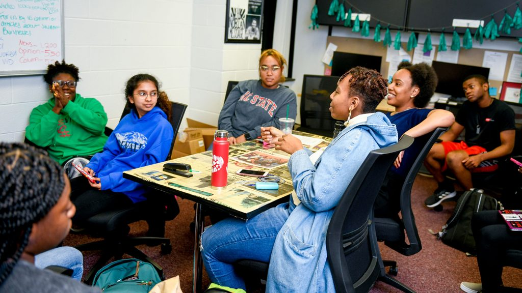 Students discuss the next issue at a Nubian Message staff meeting