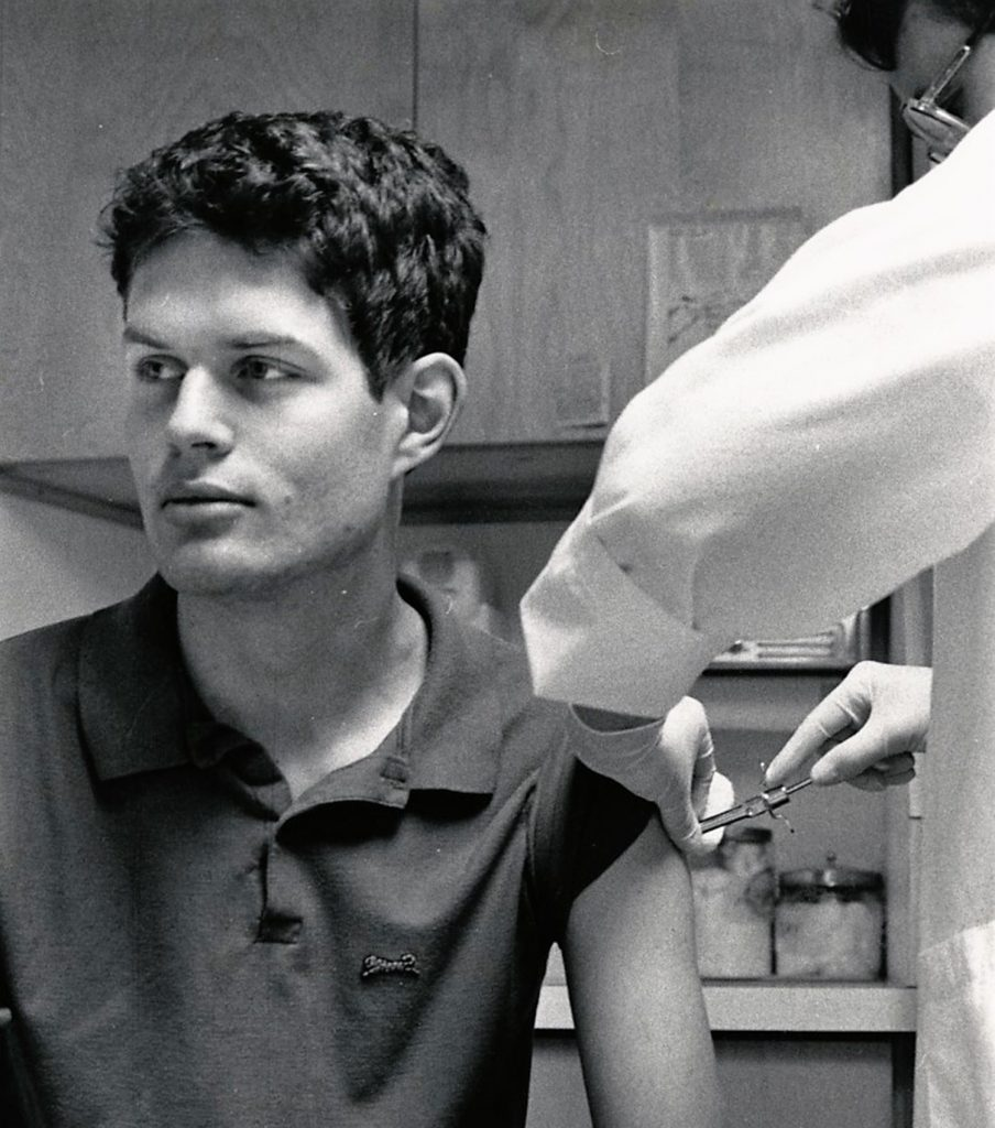 A student is vaccinated by a doctor during the 1989 measles outbreak.