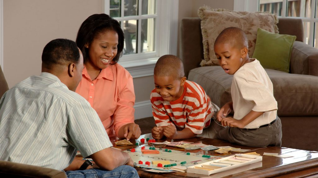 A family playing a board game together