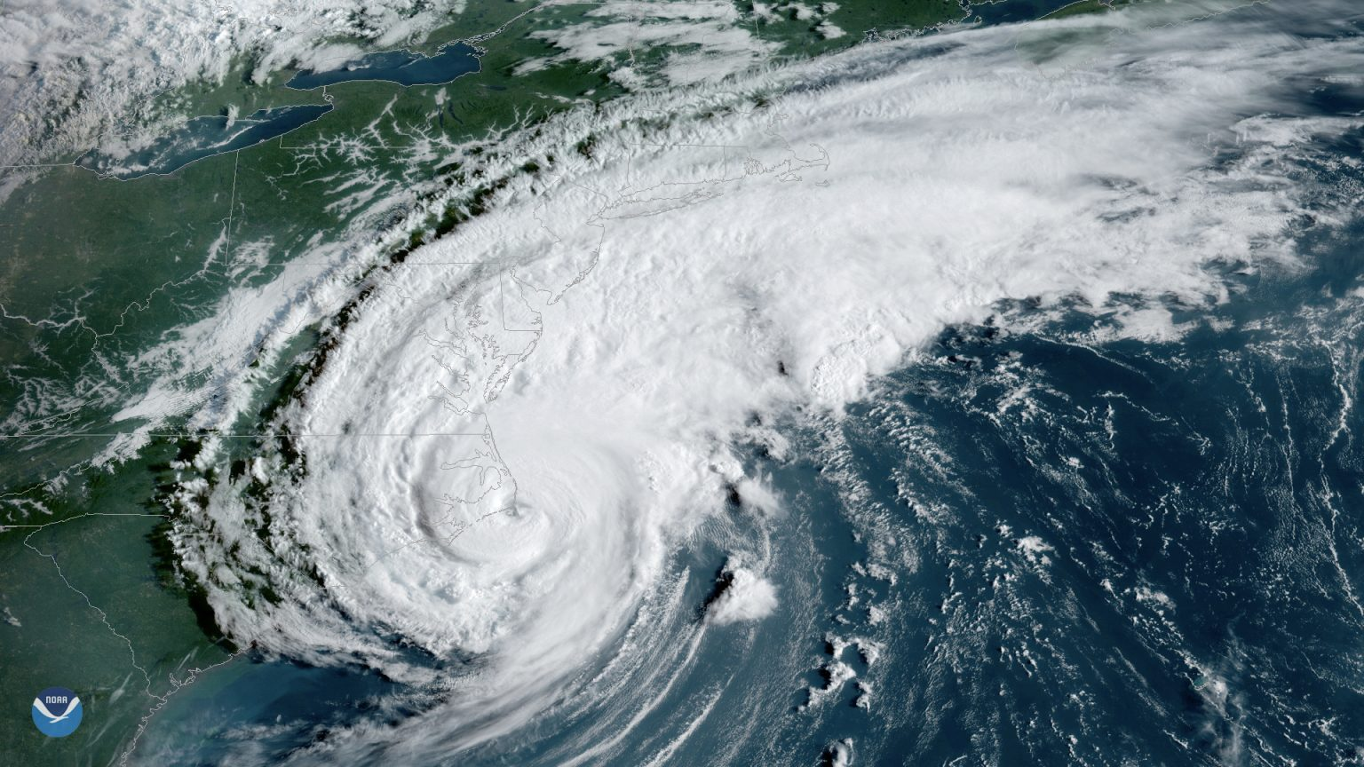 Hurricane Dorian appears as a swirl of white clouds over the US coast