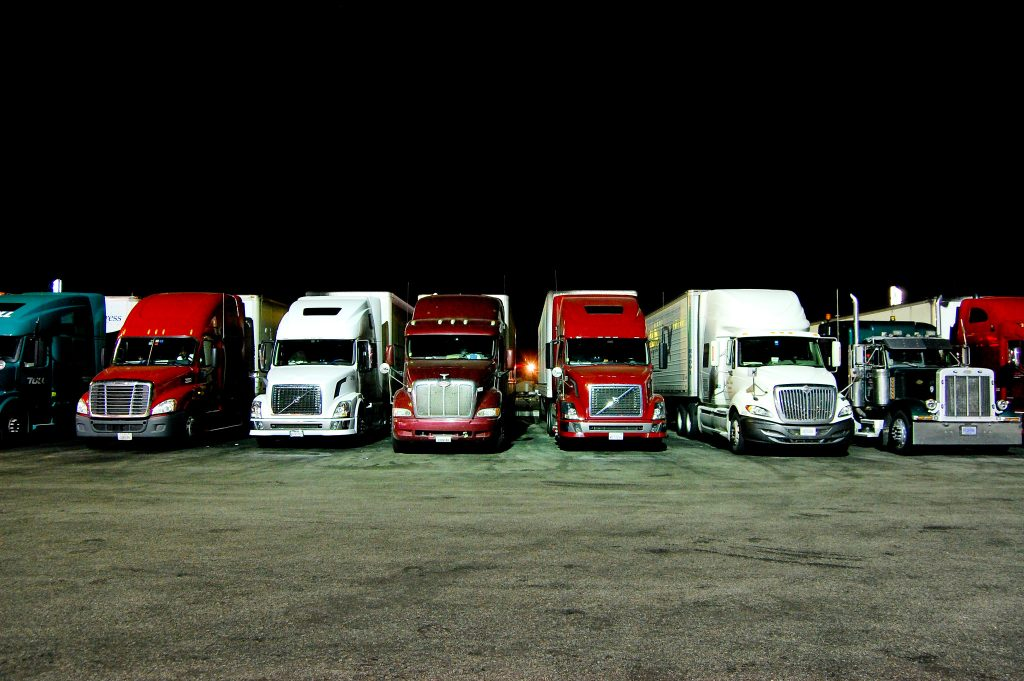 tractor trailers lined up in a parking lot