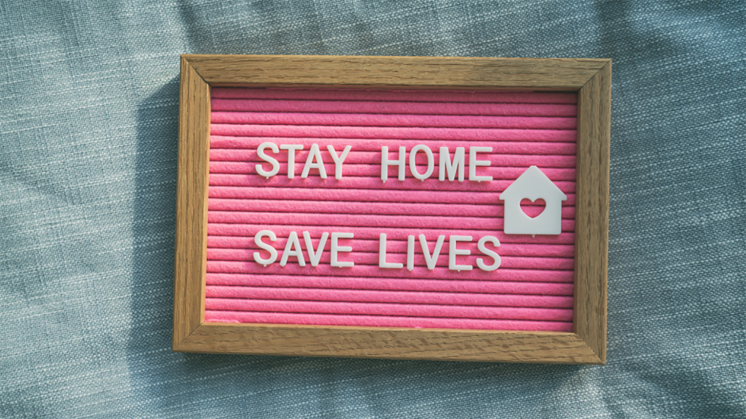 "sign that says ""stay home, save lives"""