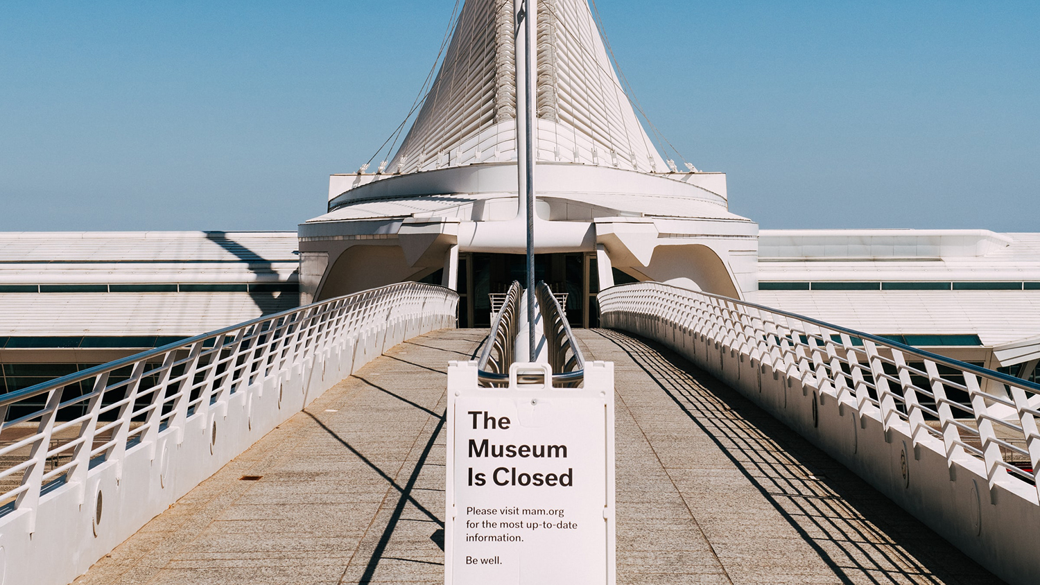 museum with closed sign in front