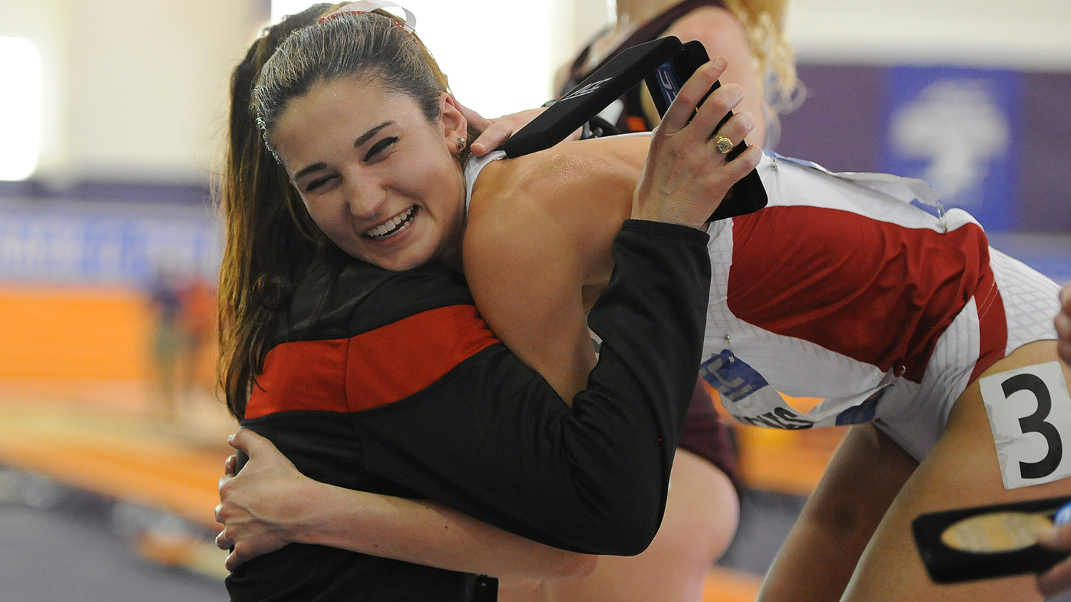NC State cross country runner Elly Henes hugging her coach