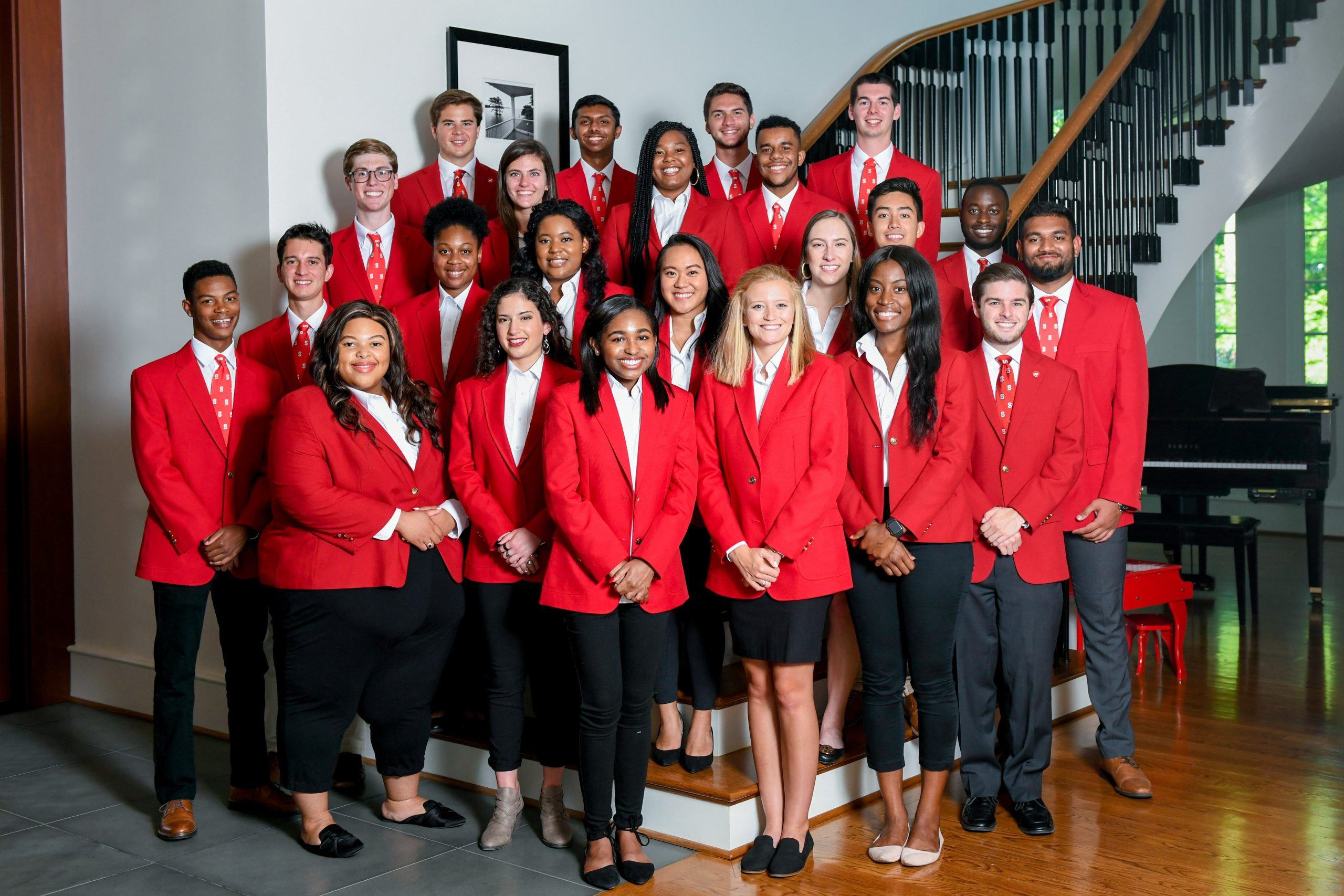 The 2019-2020 Chancellor's Aides take a group photo on a staircase.