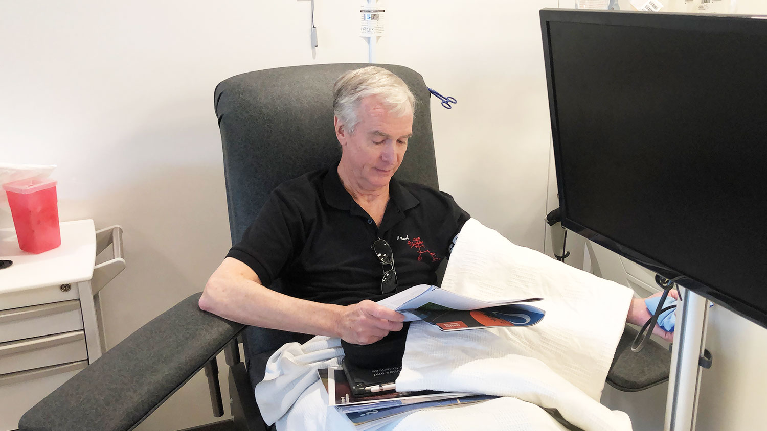 man sitting in chair donating platelets