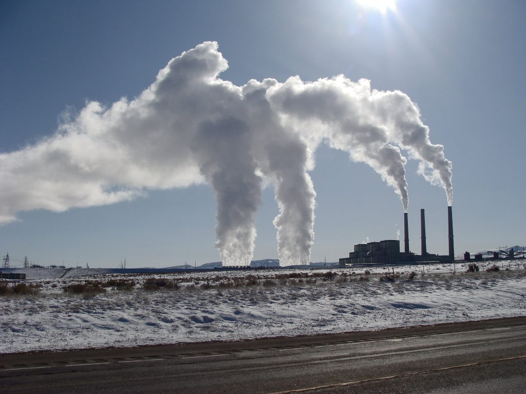 The image shows air pollution from a plant.