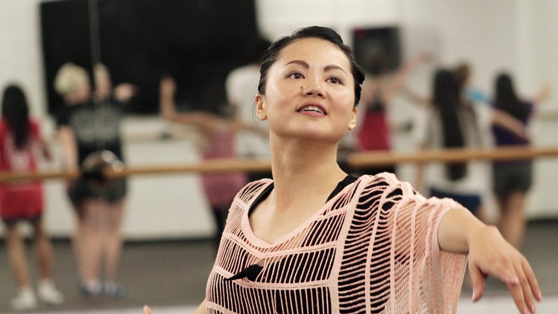 A dance teacher leads a class
