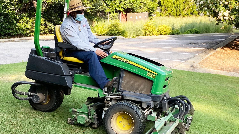 man on riding mower