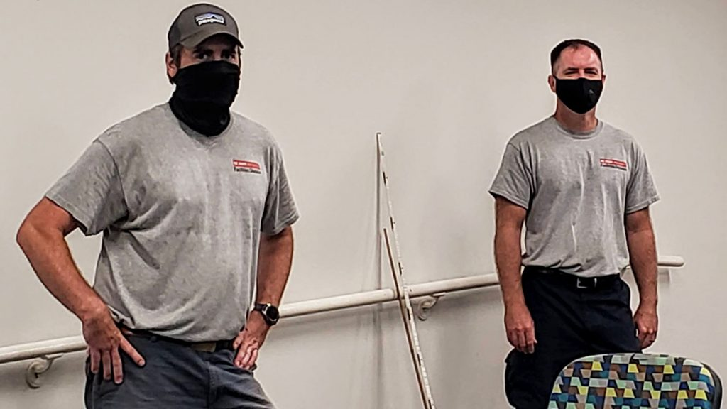 two facilities employees wearing masks