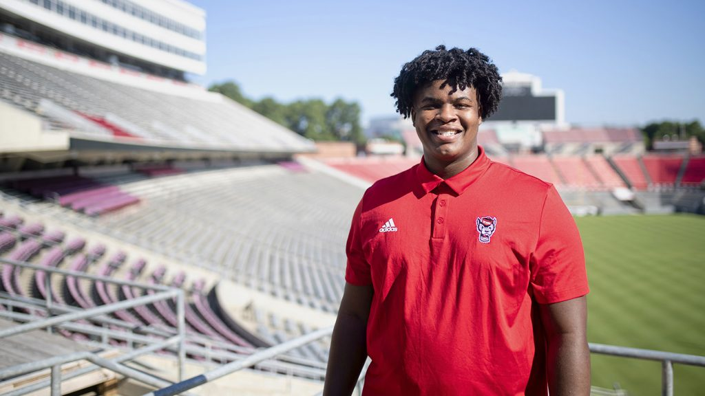 Anthony Carter, a first-year football player, stands for a portrait in Carter-Finley Stadium.