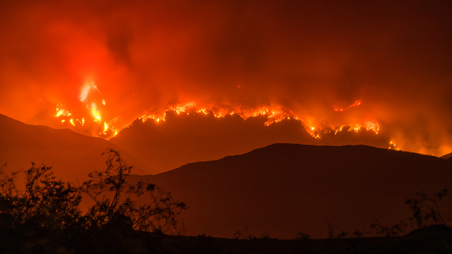 a wildfire in the hills of california