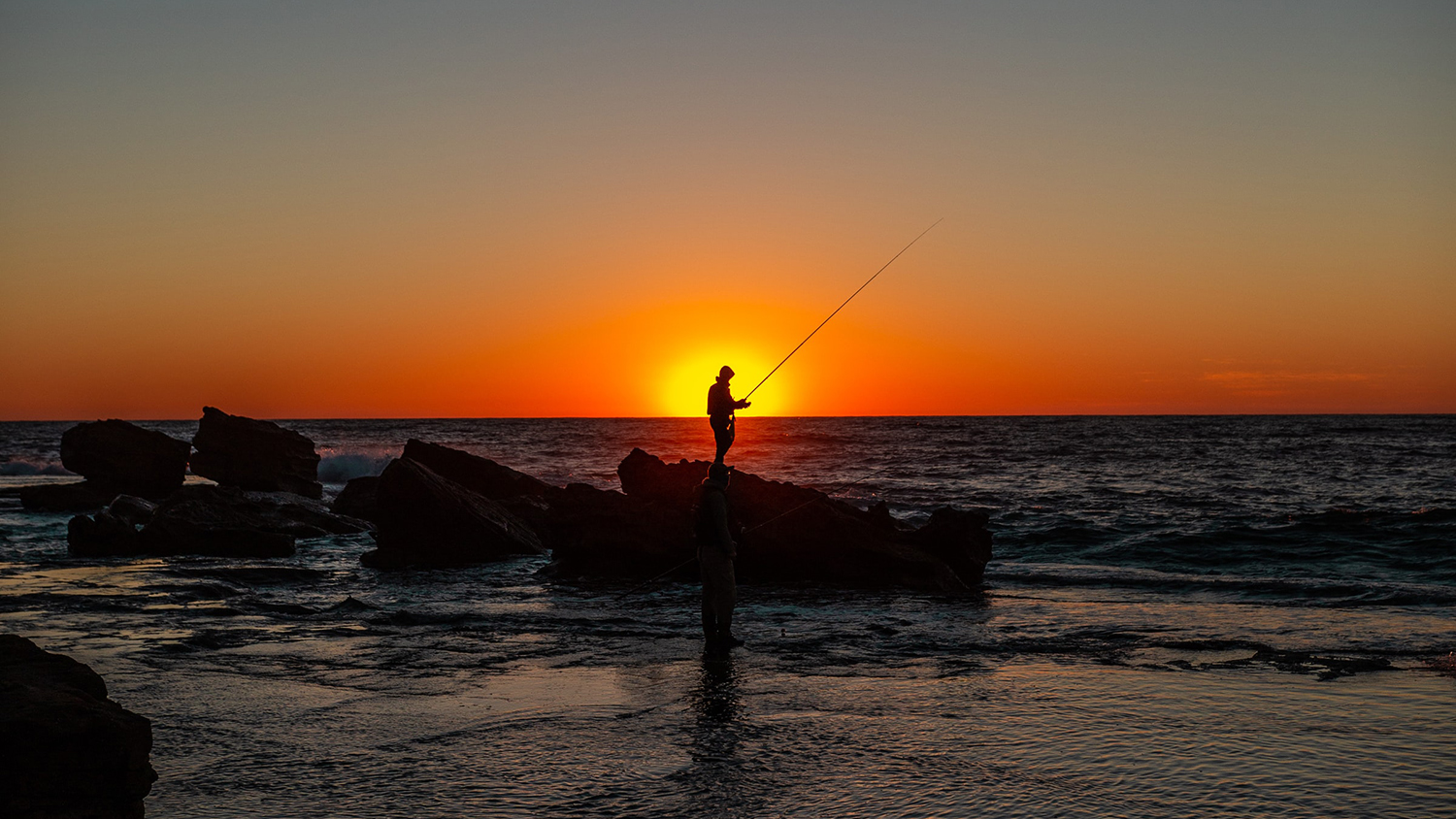 an angler fishing on the shore