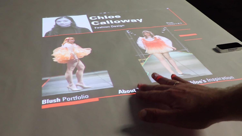 A monitor shows fashion design portfolios in the new Innovation Studio