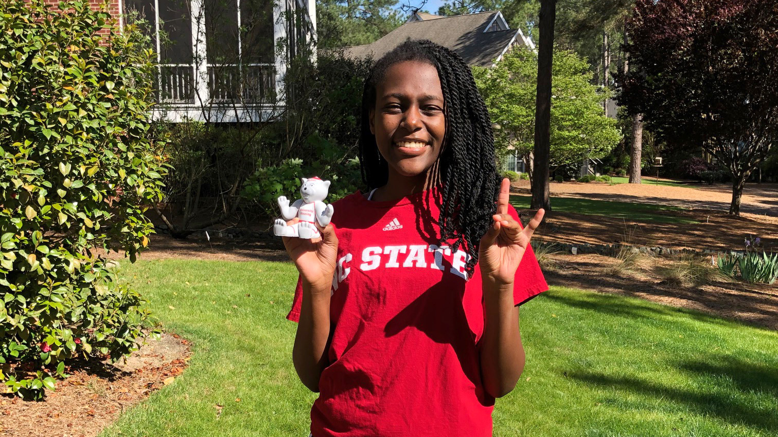 Niasha Kodzai poses outside wearing an NC State T-shirt.