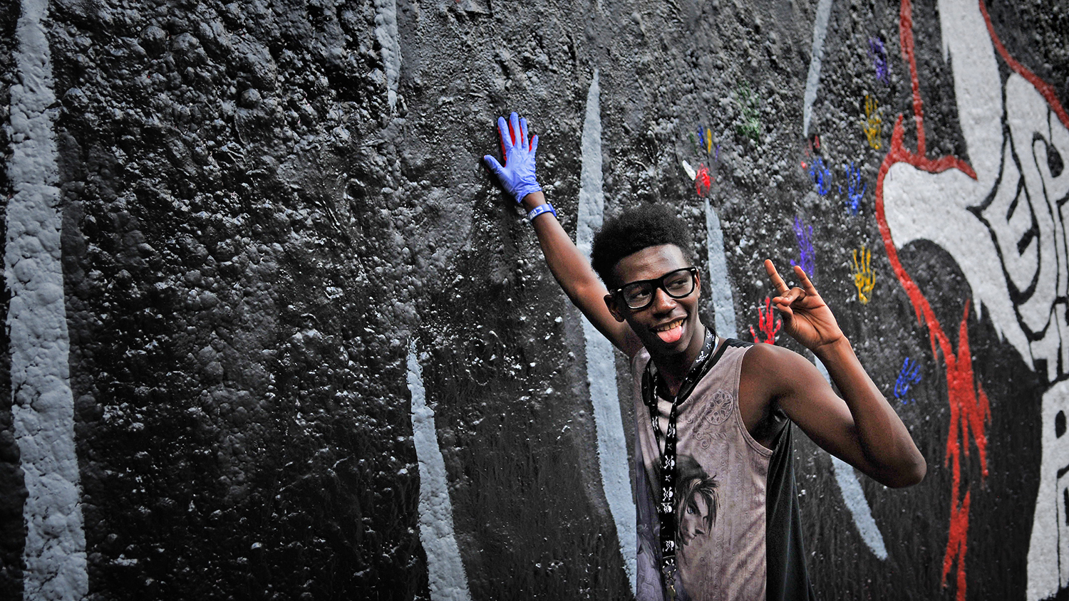 A student adds his hand print to the Free Expression Tunnel in 2017 as part of NCState's Respect the Pack event.