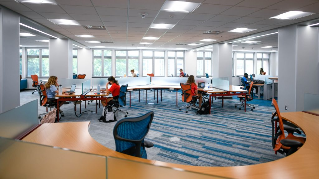 Students work in the Hill Library during the first week of the fall 2020 semester.
