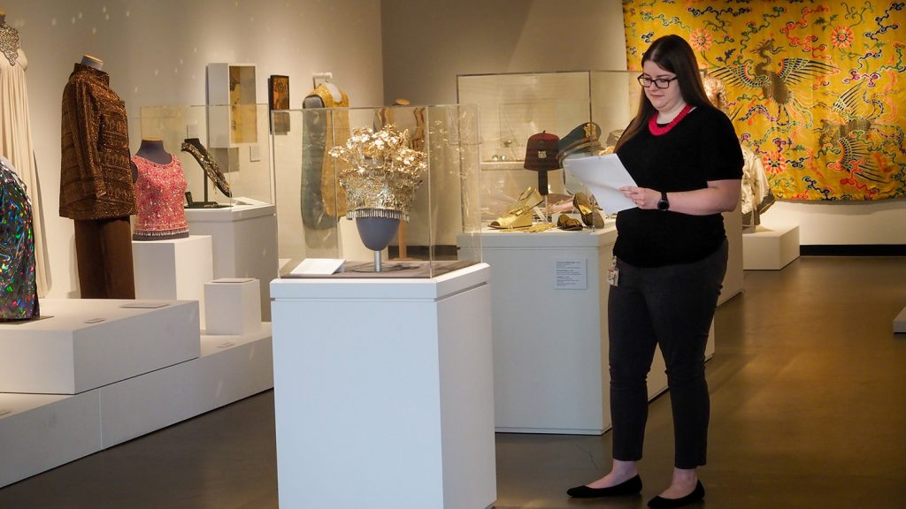 Assistant Registrar Jordan Cao examines a list of items in the Gregg Museum's collection.