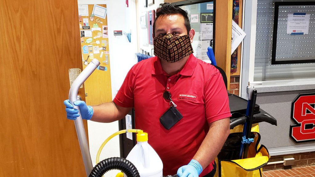 housekeeper with cleaning supplies and equipment