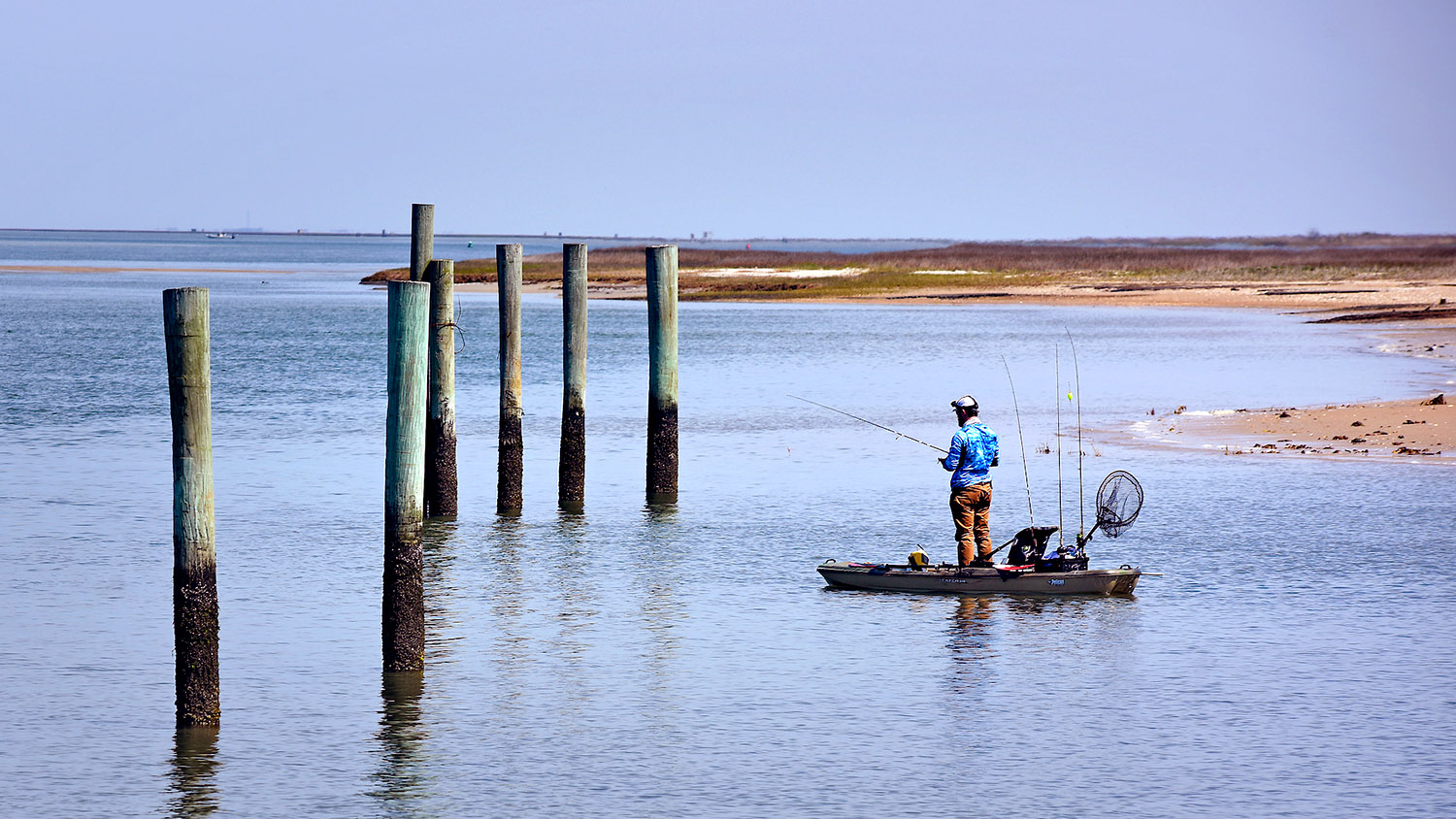 A fisherman tries his luck fishing Barden Inlet along the Cape Lookout shoreline.