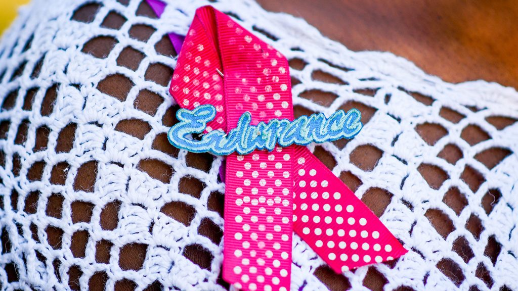"""breast cancer ribbon pin with the word """"endurance"""""""