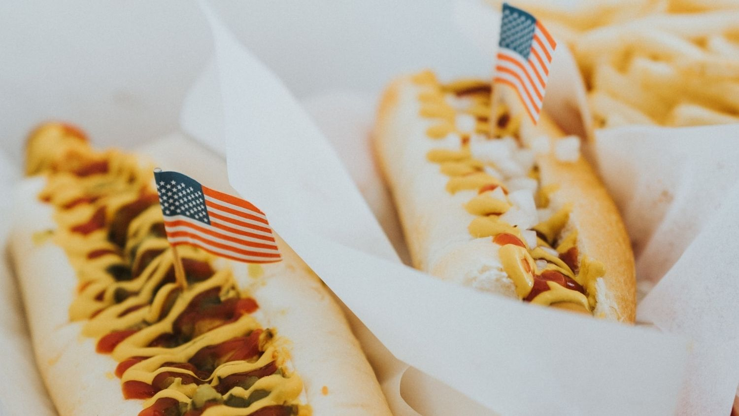 Hot dogs with American flag decorations.