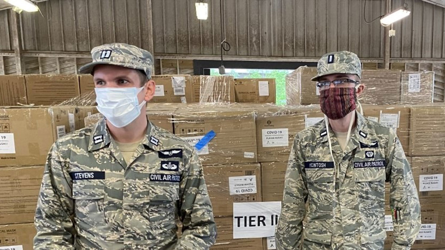 two men in Civil Air Patrol uniforms at a PPE distribution site in NC