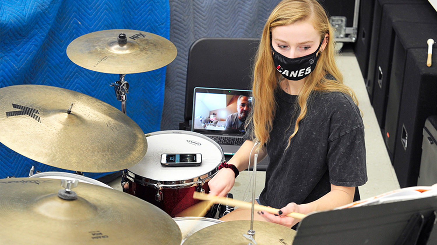 Student AnnE Ford takes online drum classes.
