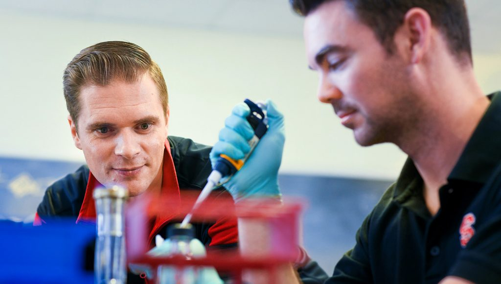 Dr. Rodolphe Barrangou works with another researcher in his lab in Schaub Hall.