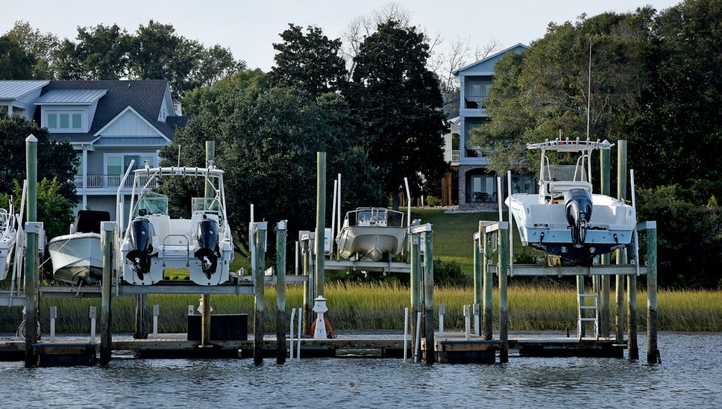 Boats on lifts and homes along Middle Sound near Wilmington.