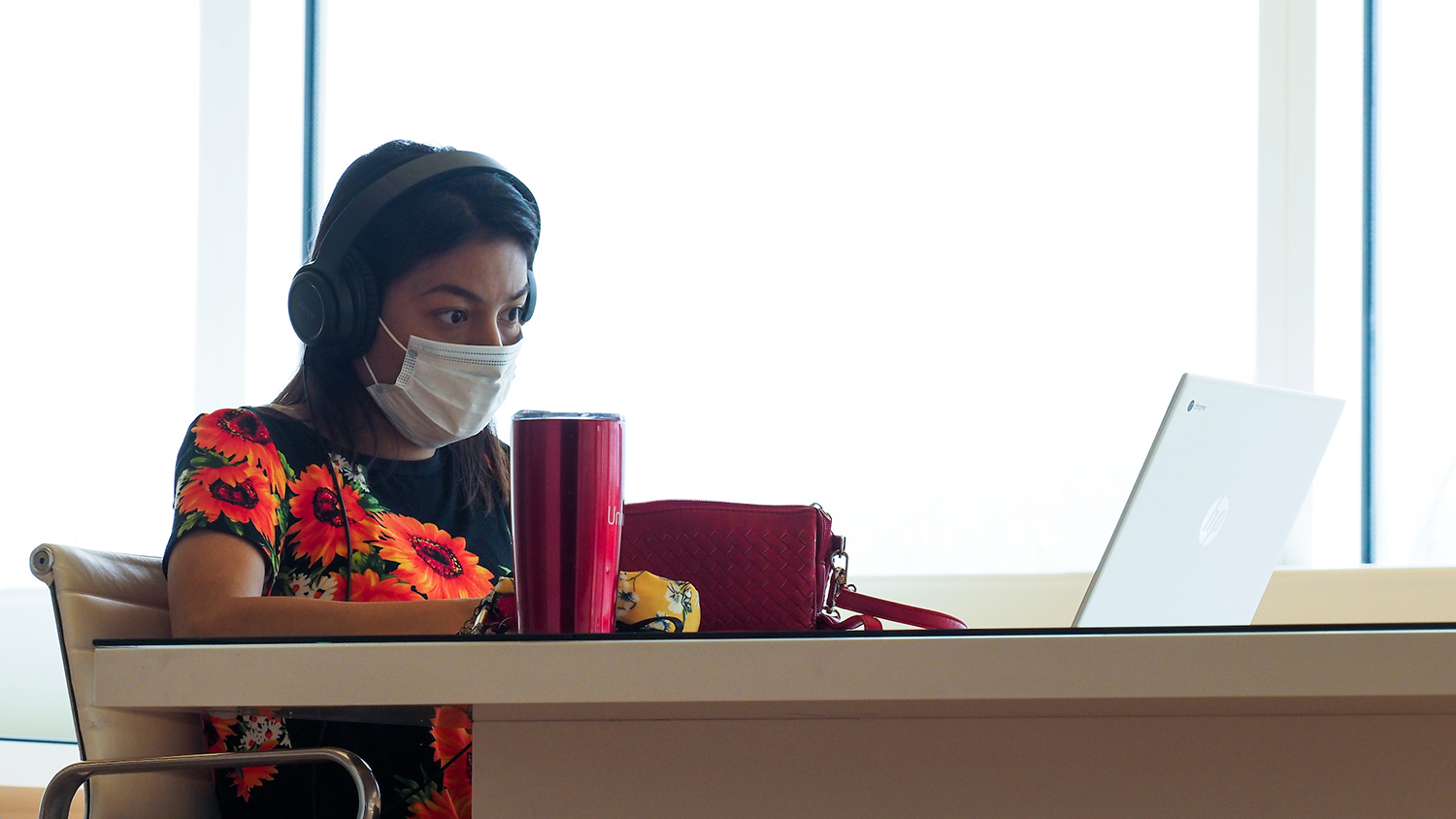 A student works in the Hunt Library during the COVID-19 pandemic.