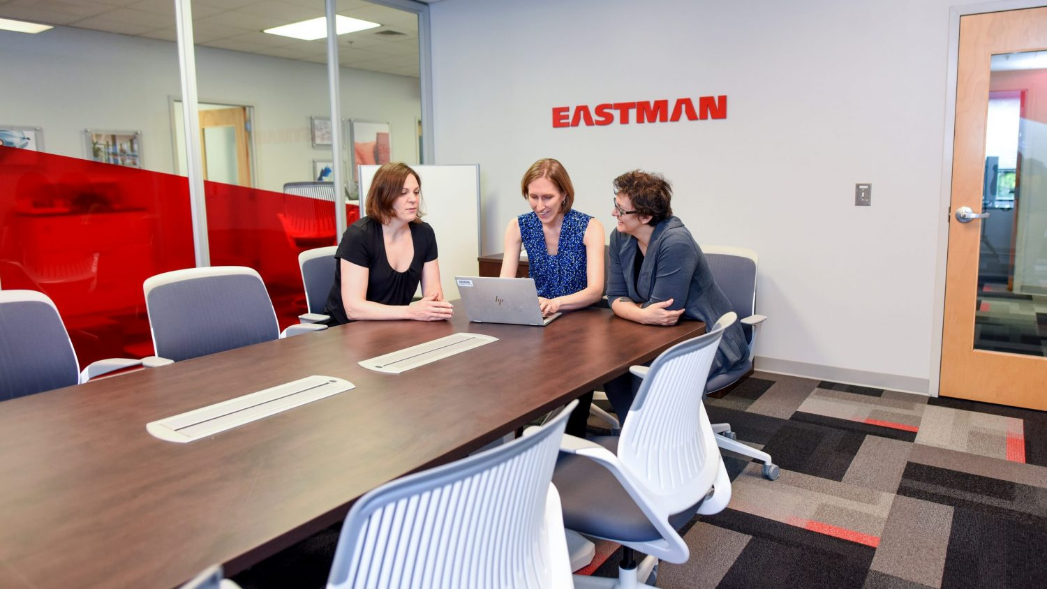Employees collaborate in the Eastman office.
