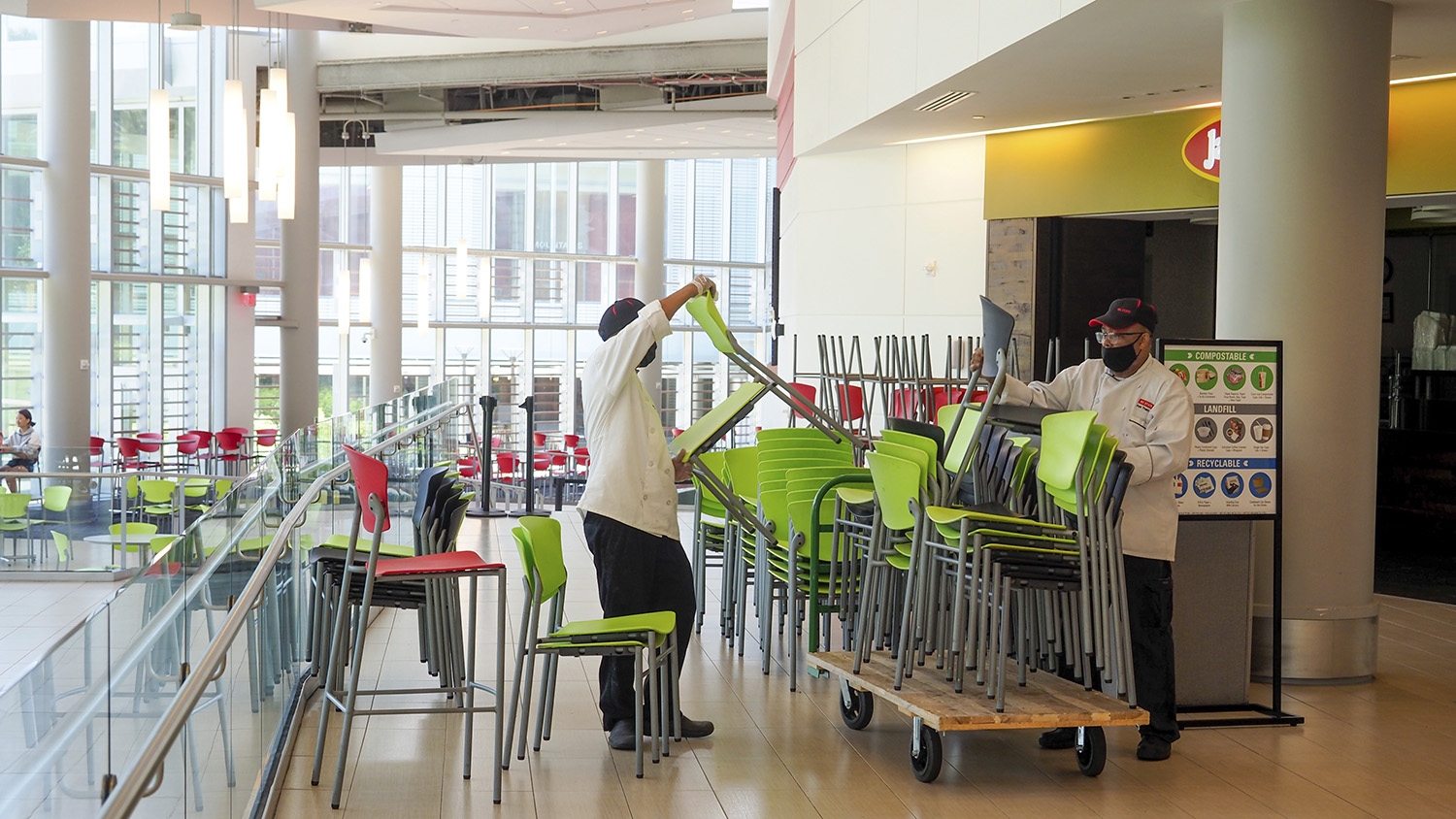 Workers remove chairs from Talley Student Union to limit seating capacity during the COVID-19 pandemic.