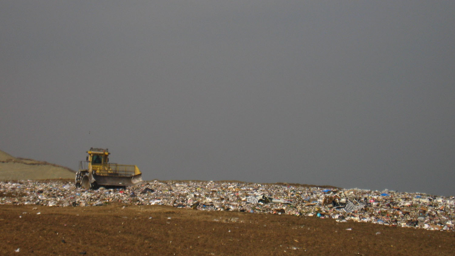 bulldozer in a landfill