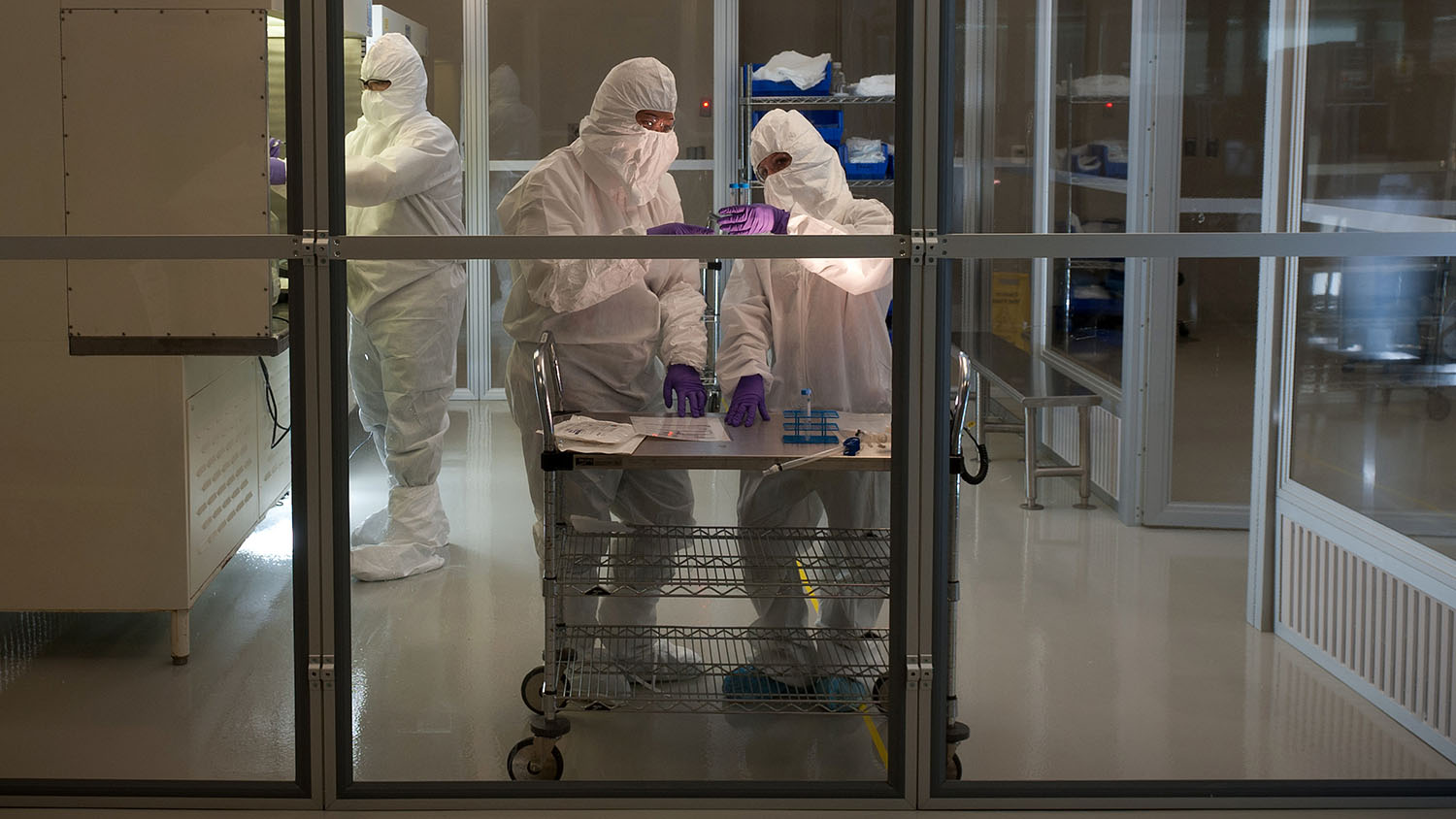 two workers in a biomanufacturing facility