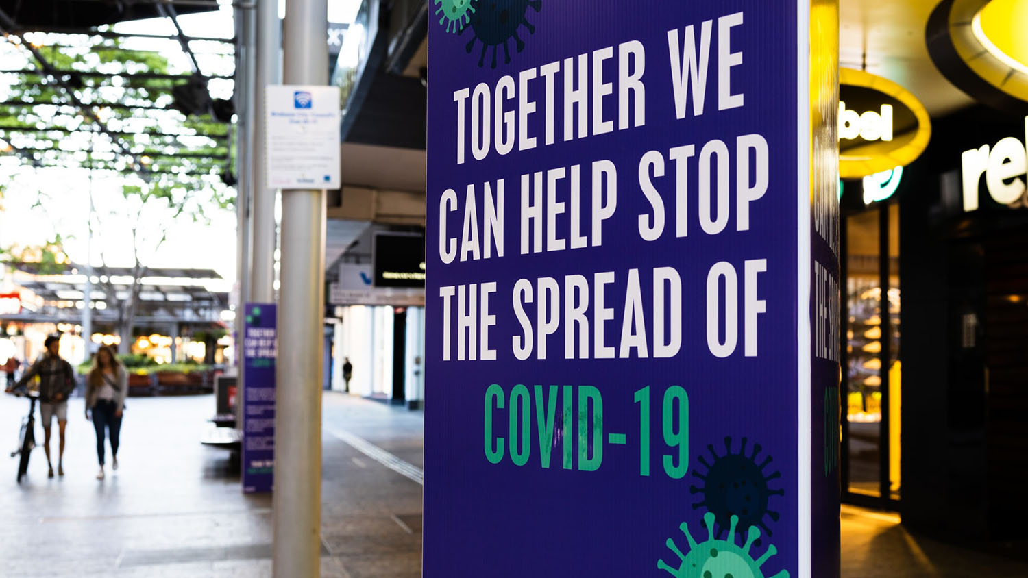 "sign reading ""together we can help stop the spread of covid-19"""