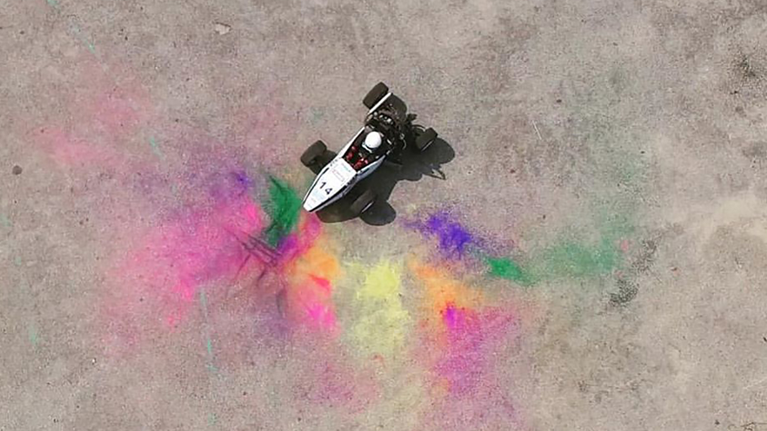 "The photo ""testing + holi"" shows an engineering project centered in colorful powder."
