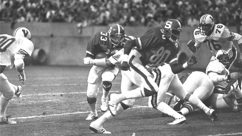 Billy Ray Vickers evades a tackle in a technician photo from the 1970s.