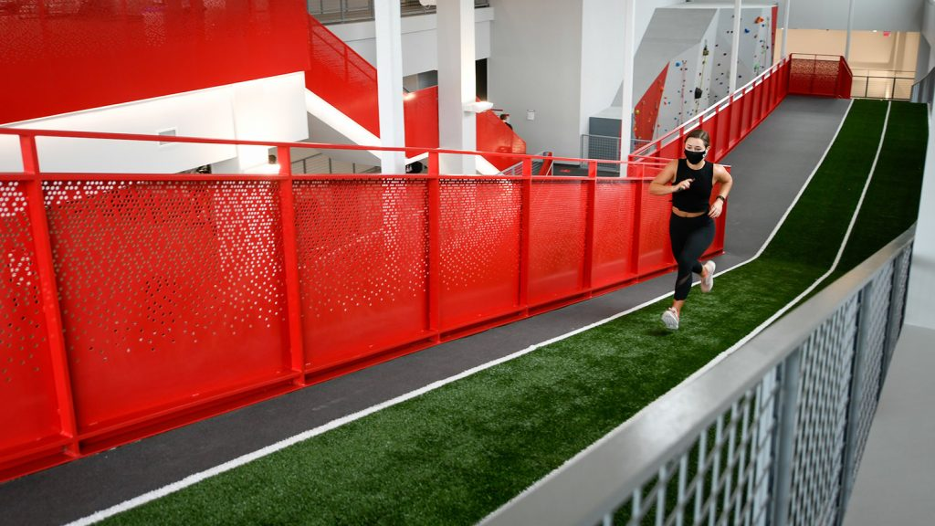 runner on turf sprint ramp at NCState's Wellness and Recreation Center