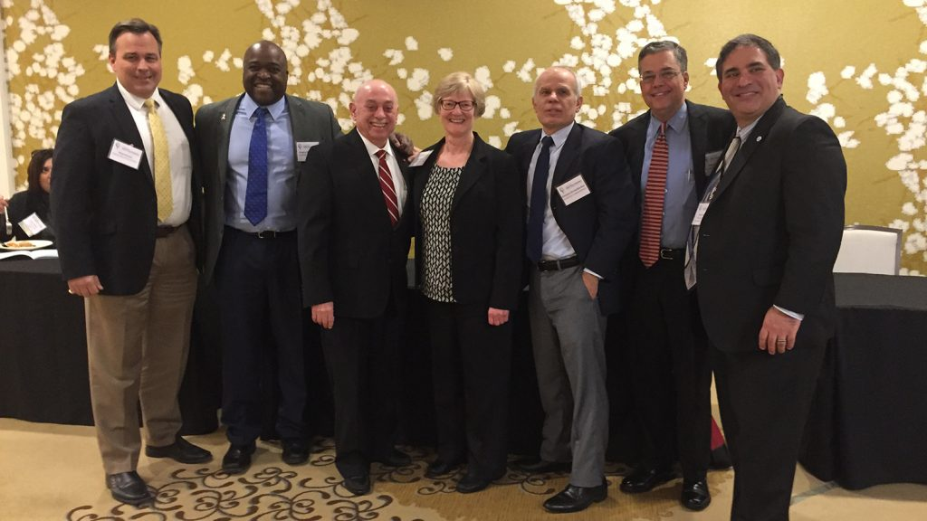 Group of academic leaders connected to NC State pose at an Alumni Association event.