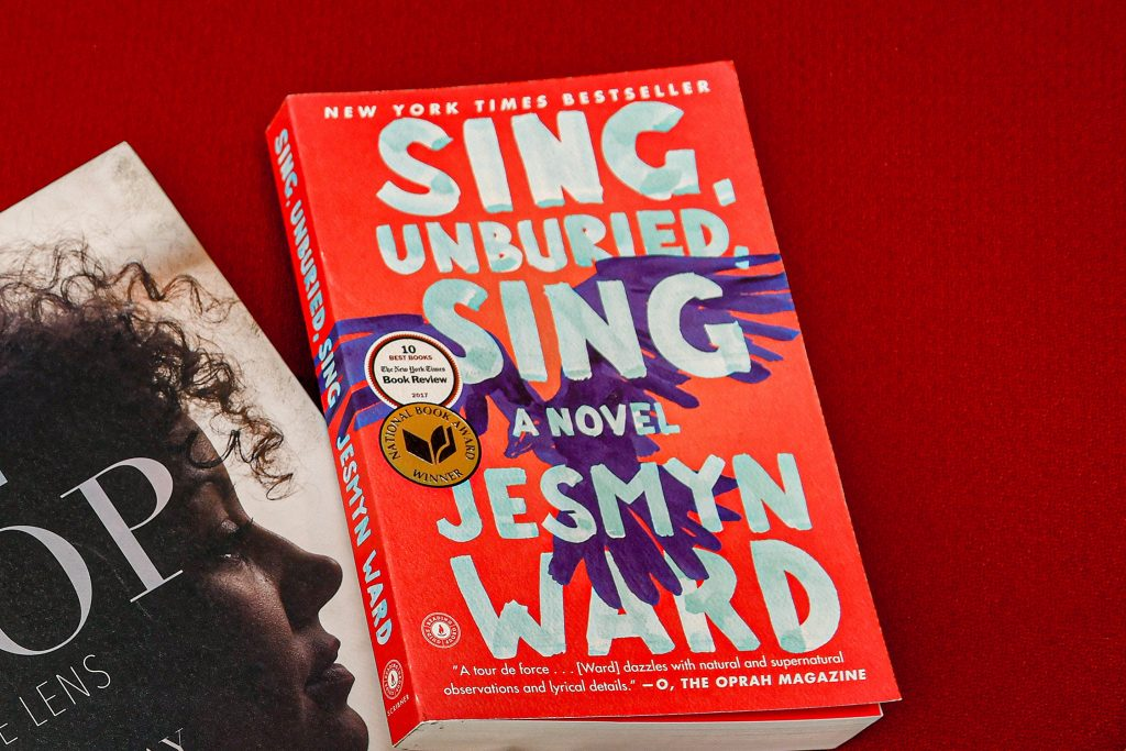 A copy of the book Sing, Unburied, Sing.