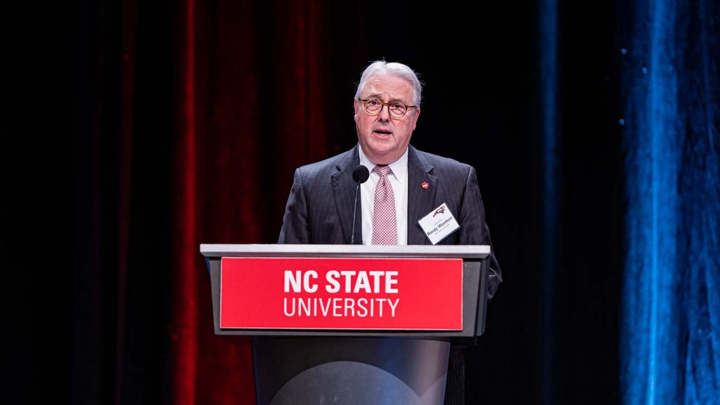 Chancellor Randy Woodson at podium at forum.