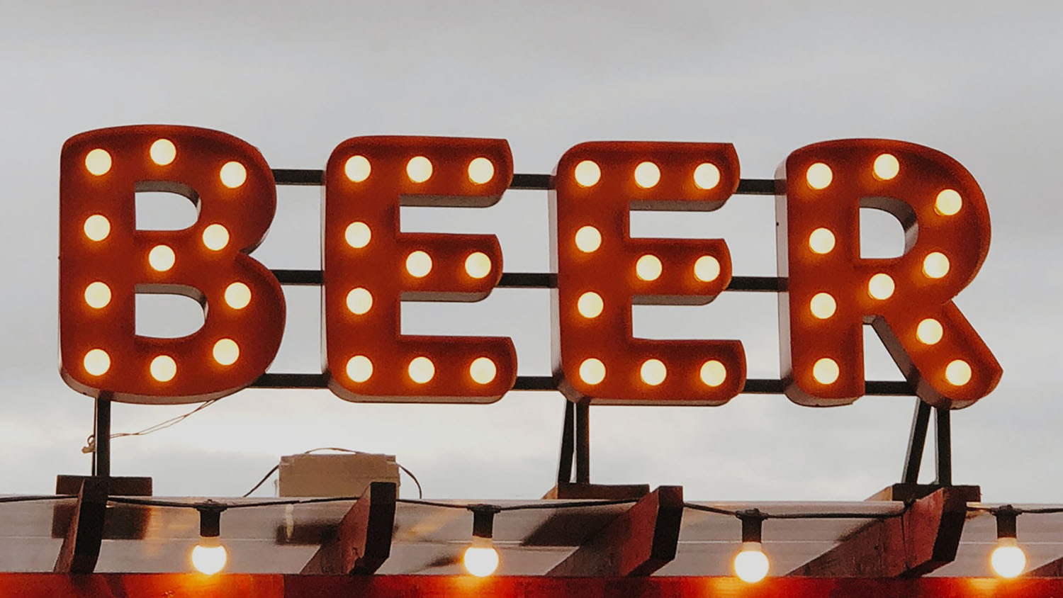 sign that says beer