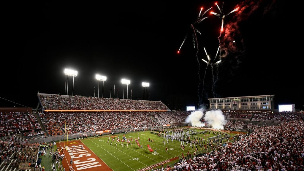 Fireworks light the sky during an evening football game at NCState.