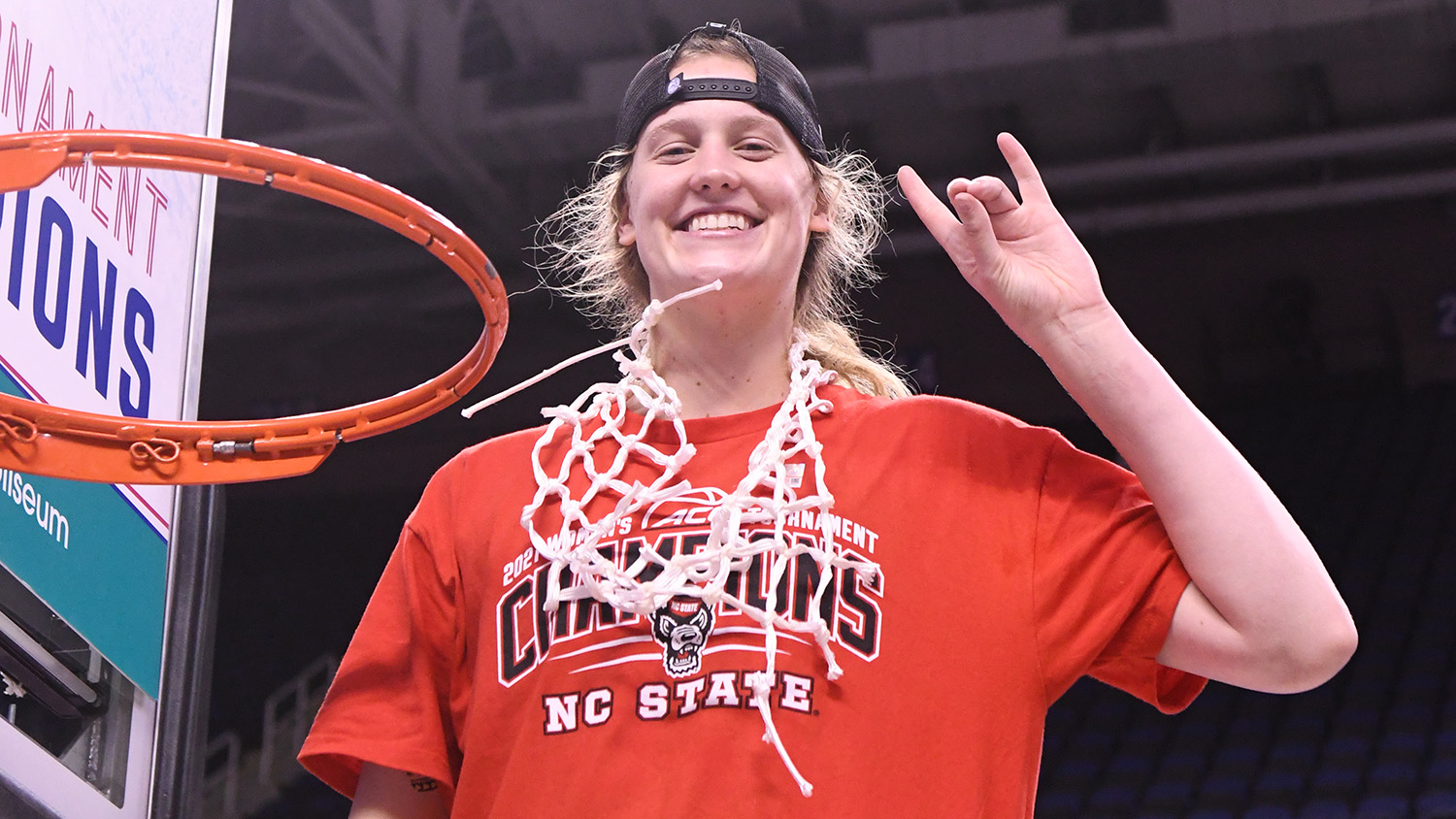 Elissa Cunane cutting down the net after a championship game.